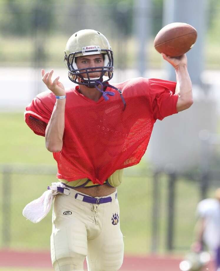 Montgomery quarterback Josh Bolfing drops back to pass during the Bears' spring game Thursday. To view or purchase this photo and others like it, visit HCNpics.com. Photo: Jason Fochtman