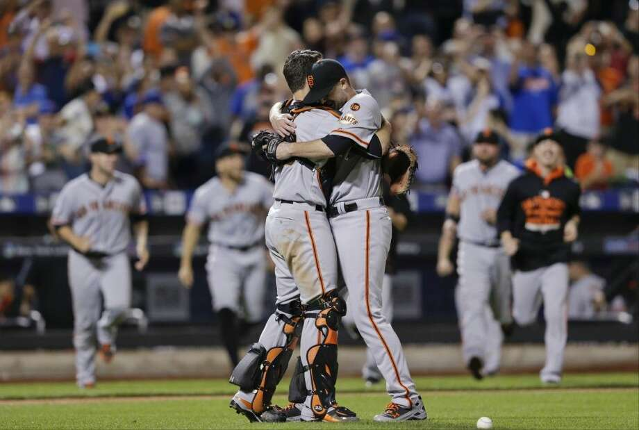 San Francisco Giants starting pitcher Chris Heston hugs catcher Buster Posey, left, after Heston's no-hitteragainst the New York Mets on Tuesday.in New York. Photo: Frank Franklin II