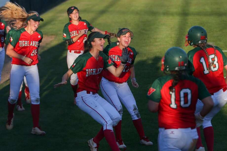The Woodlands teammates celebrate after they score a run during the high school softball game on Friday at The Woodlands High School. To view more photos from the game, go to HCNPics.com. Photo: Michael Minasi