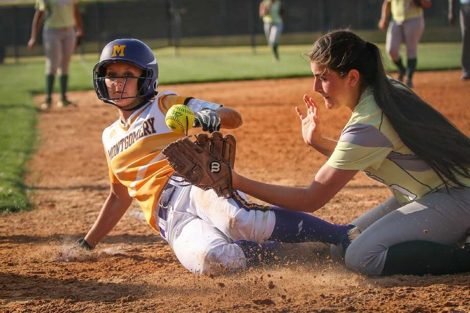 Montgomery's Bailee Kieselhorst (6) slides home as Klein Forest's Celeste Flores (9) tries for a tag during a high school softball game on Monday at Klein Forest High School. To view more photos from the game, go to HCNPics.com. Photo: Michael Minasi