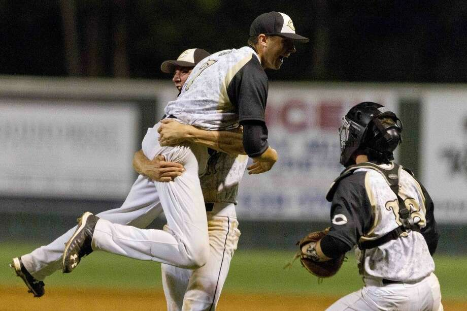 Conroe pitcher John Waling gets lifted up into the air by Riley Wohlschlaeger after striking out AtascocitaÕs Bailey Mullins to get the save and give the Tigers a 7-5 victory over the Eagles during a District 16-6A baseball game Tuesday at Conroe High School. Go to HCNpics.com to purchase this photo and others like it. Photo: Jason Fochtman