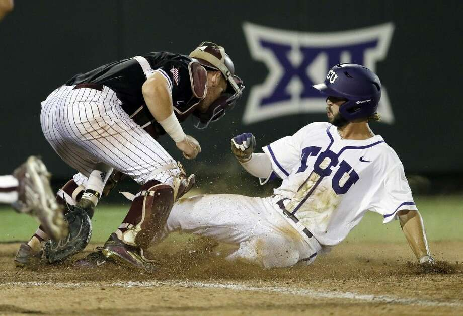TCU's Garrett Crain, right, scores the winning run during the 16th inning of a super regional in Fort Worth on Monday. Photo: Tim Sharp