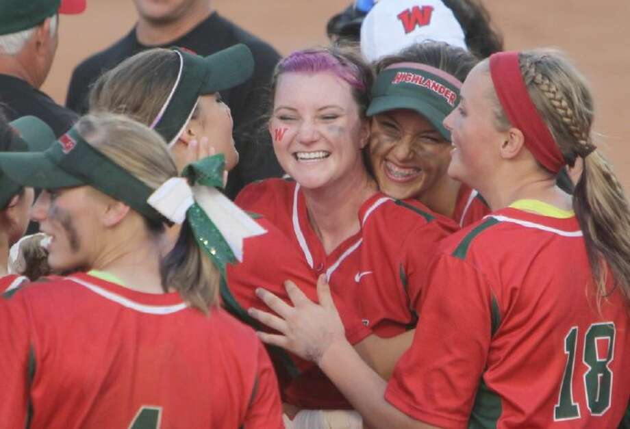 The Woodlands' Amy Harvey, center, and Shelby Dublin, center right, celebrate with their teammates after beating Southwest 12-2 in six innings in the Class 5A semifinals on Friday in the UIL state softball tournament at Red and Charline McCombs Field in Austin. To view or purchase this photo and others like it, visit HCNpics.com. Photo: Jason Fochtman