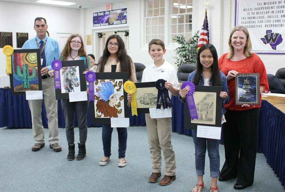 Pictured left to right:J eff Scates, teacher, holding artwork of Elizabeth Vickery (not present), Lynn Lucas Middle School - Gold Medal Elizabeth Edwards, Willis High School - Best of Show Jasmine Gonzalez, Lynn Lucas Middle School - Best of Show Hutton Hoegemeyer, AR Turner Elementary - Gold Medal; Power of Art Nominee Ivy Nguyen, AR Turner Elementary - Best of Show Willis ISD - Super Show Hall of Fame Award, held by Christie Franz, Administrative Assistant Not present; artwork not shown: Kaitlyn Erickson, Willis High School - Gold Medal; Brianna Poff, Willis High School - Gold Medal.