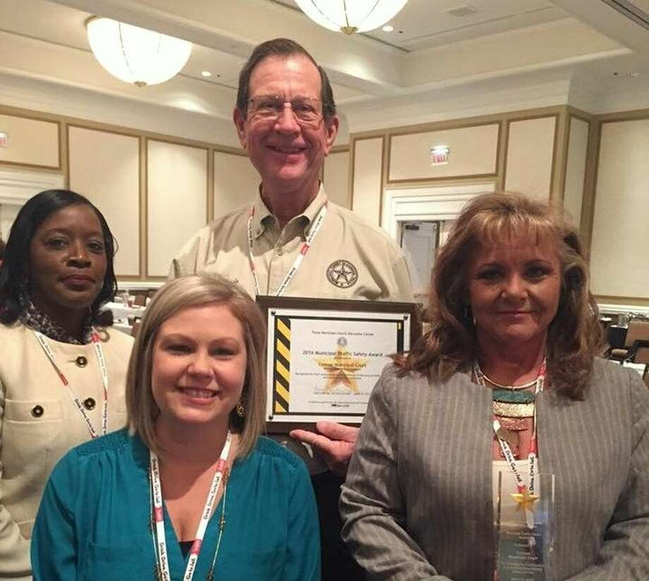 Conroe Municipal Court was presented with a 2016 Traffic Safety Award. Left to right: Eva Glaspie, Christina Roley, and Ronda Scarborough. Back: Municipal Court Judge Mike Davis. Photo: Picasa
