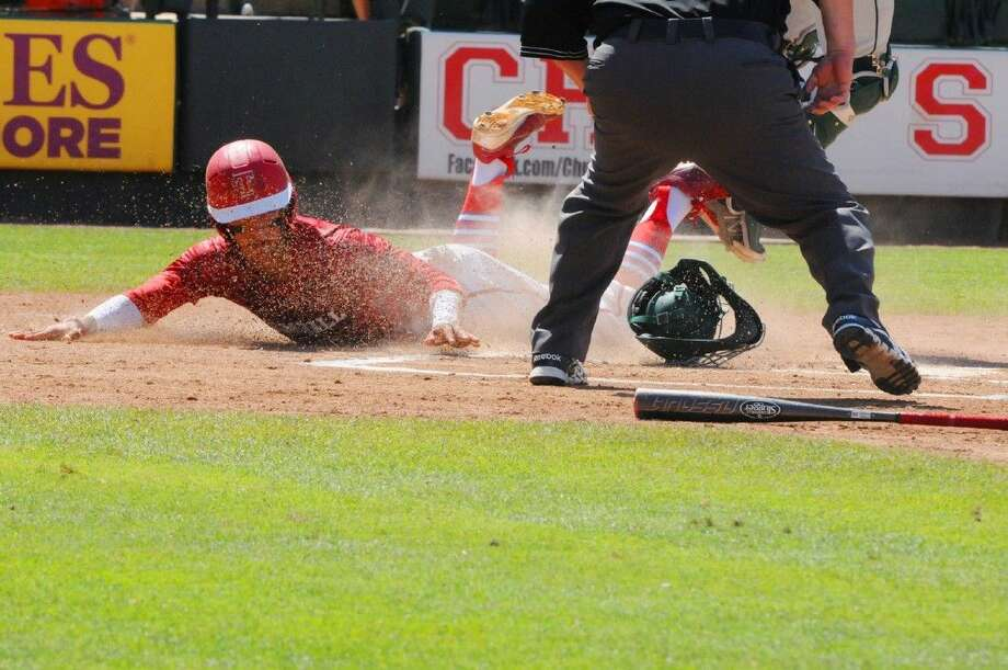 Tomball's Mark Bonnian slides in safely to home plate during a loss to Prosper in the Class 5A state semifinals. The Cougars went on to lose 6-2 at Round Rock's Dell Diamond.