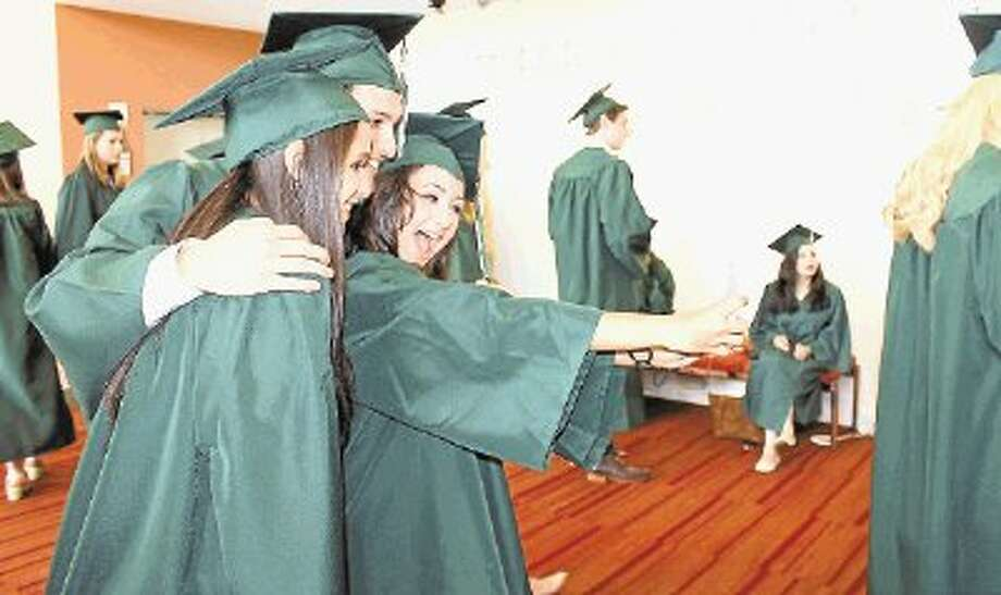 Cooper grads Pamela Pimienta and Luis Canavati pose for a selfie taken by Andrea Ramirez. / @WireImgId=2678148