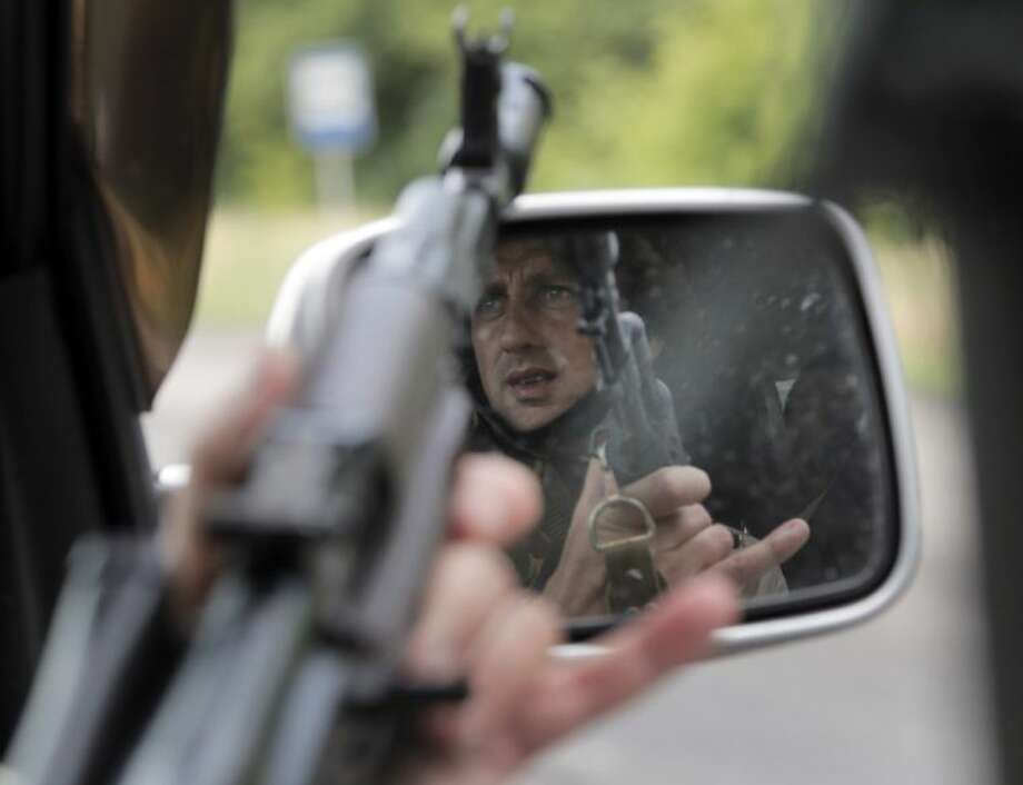 A gunner of the Ukrainian army gets ready to shoot as they move to position in Slovyansk, Ukraine, Saturday.