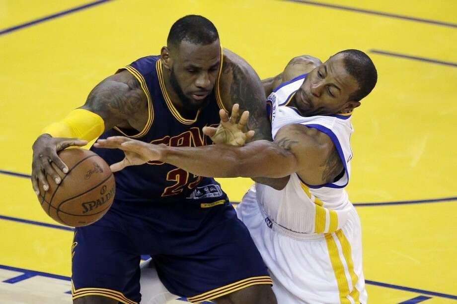 Cleveland Cavaliers forward LeBron James, left, is guarded by Golden State Warriors forward Andre Iguodala during the second half of Game 2 of the NBA Finals in Oakland, Calif., Sunday. Photo: Eric Risberg