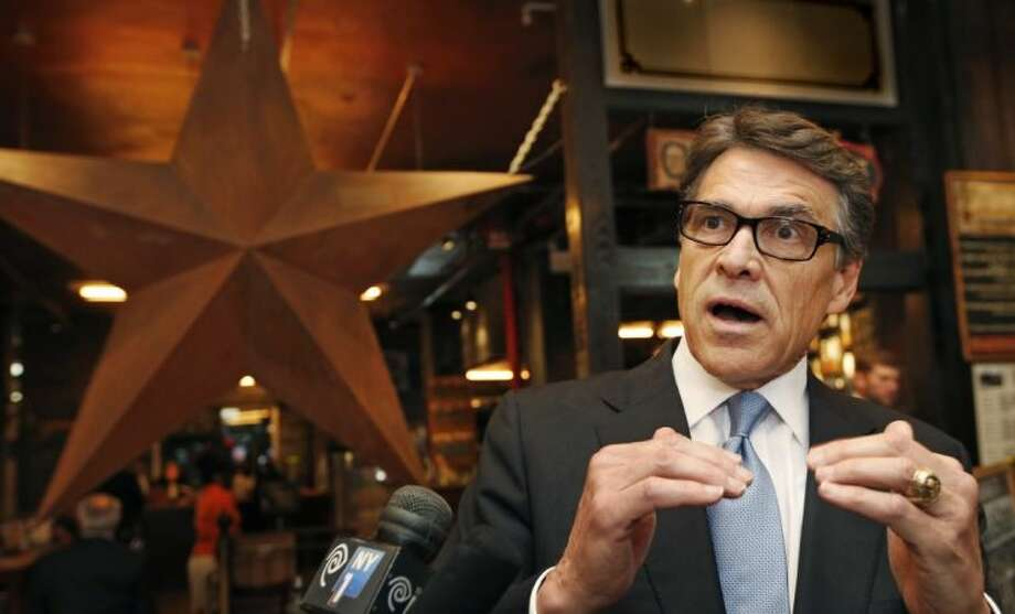 In this April 23 file photo Texas Gov. Rick Perry speaks in New York after trying to convince companies to move their operations to Texas. If Perry opts to make a second presidential run, his business-friendly policies in Texas will be his main selling points. But back home, members of his own party seem poised to dismantle key parts of his legacy. Among the targets: the special state funds Perry used to attract top employers to Texas.