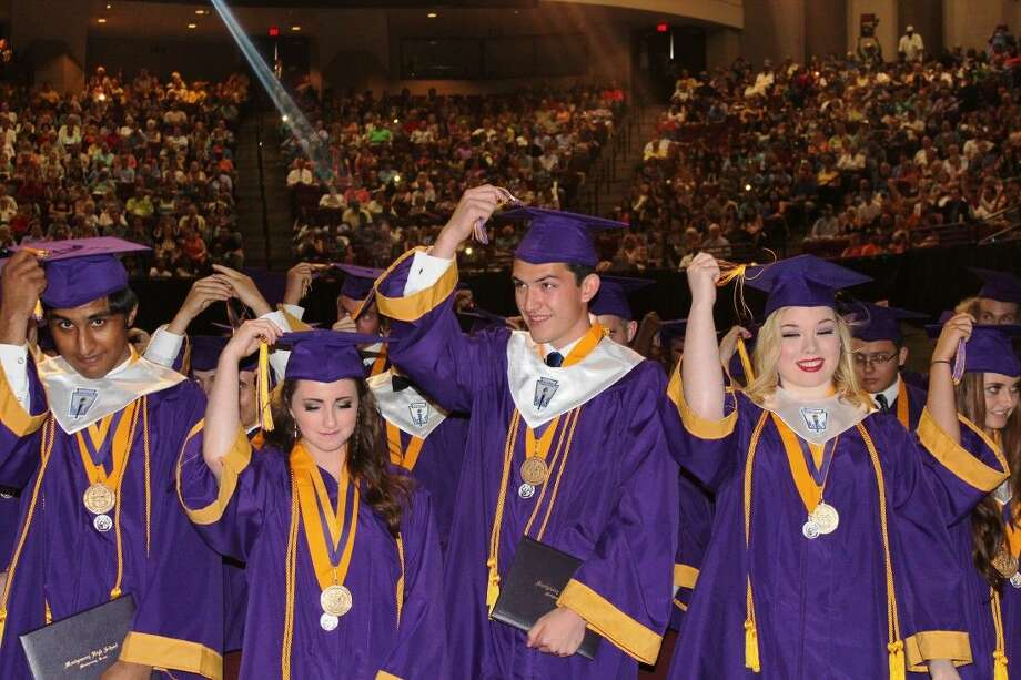 Montgomery High School seniors turn their tassels after the school's commencement ceremony at Texas A&M University on Friday.