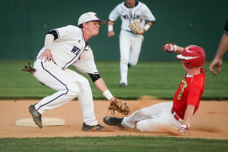 Willis' Christian Cornelius (8) tags Caney Creek's Zach Greenhouse (8) at second base during the high school baseball game on Tuesday, April 26, 2016, at the Willis High School Baseball Complex. To view more photos from the game, go to HCNPics.com. Photo: Michael Minasi
