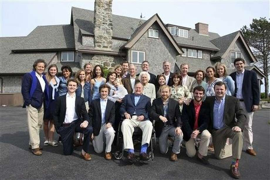 In this photo provided by the Office of George Bush, the Bush family poses for a photo at the family estate in Kennebunkport, Maine. The family gathered for a gala planned to celebrate Barbara Bush's 90th birthday on Monday. Among those present are former President George H.W. Bush, seated front row center, his wife and former first lady Barbara Bush, second row center, former President George W. Bush, third row center, his wife and former first lady Laura Bush, second row third from left, former Florida Gov. Jeb Bush, back row sixth from right, and his wife Columbia Bush, second row fourth from left. Photo: Evan Sisley
