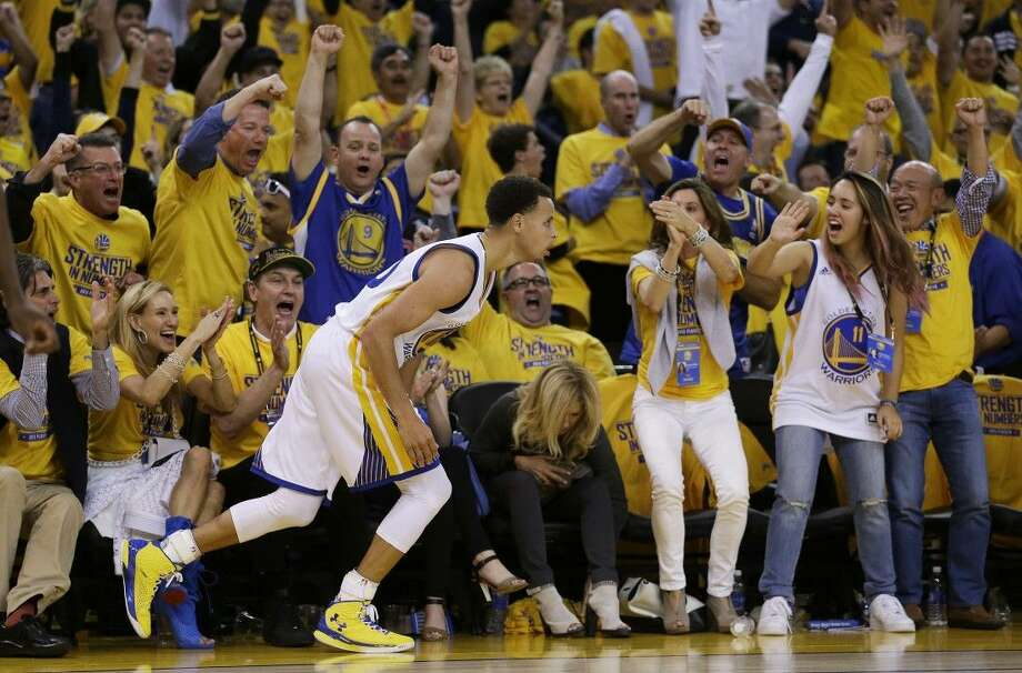 In this May 19, 2015, file photo, fans cheer after Golden State Warriors guard Stephen Curry scored against the Houston Rockets during the NBA basketball Western Conference finals in Oakland, Calif. Photo: Ben Margot