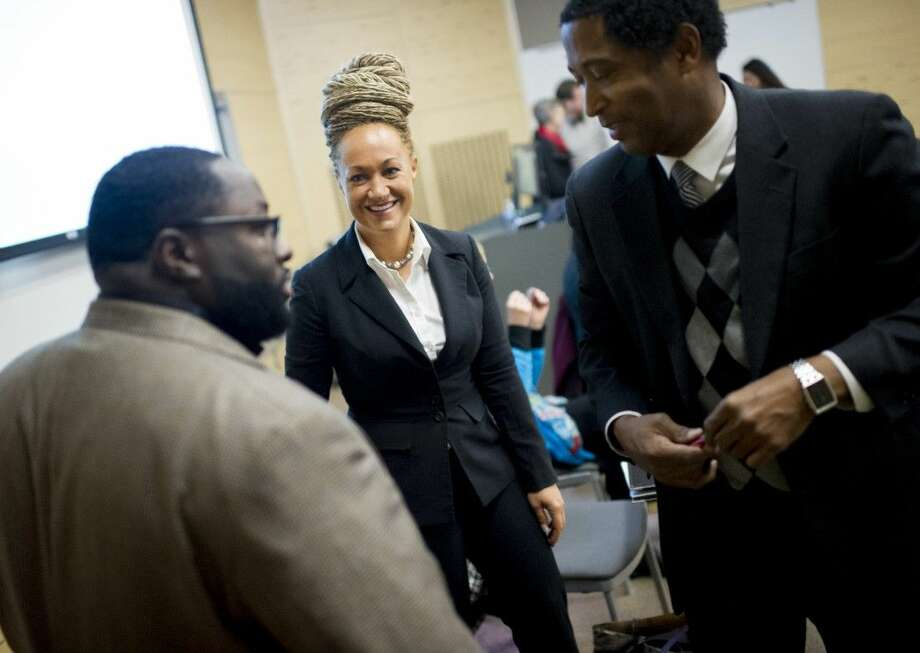 FILE — In this Friday, Jan. 16, 2015, file photo, Rachel Dolezal, center, Spokane's newly-elected NAACP president, smiles as she meets with Joseph M. King, of King's Consulting, left, and Scott Finnie, director and senior professor of Eastern Washington University's Africana Education Program, before the start of a Black Lives Matter Teach-In on Public Safety and Criminal Justice, at EWU, in Cheney, Wash. Photo: Tyler Tjomsland