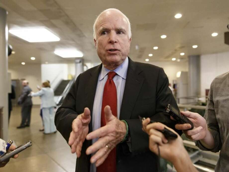 Sen. John McCain, R-Ariz., a member of the Senate Armed Services Committee who spent more than five years in captivity as a prisoner of war in North Vietnam, speaks to reporters following a closed-door briefing with intelligence officials about the Obama administration's decision to swap five members of the Taliban for captive Army Sgt. Bowe Bergdahl, at the Capitol in Washington Wednesday.