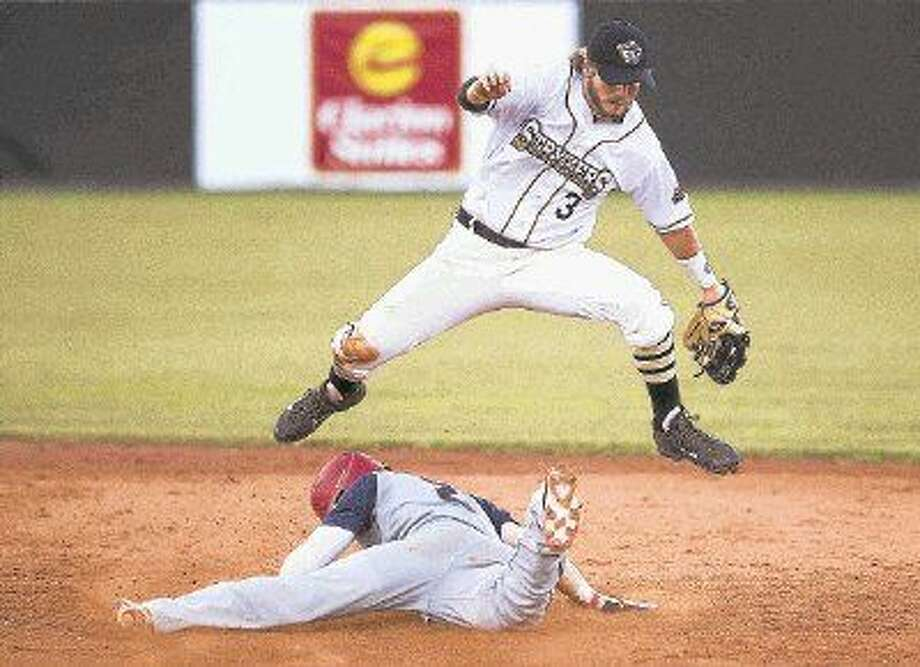 The Woodlands Stykers shortstop Lance Miles leaps over Acadiana Cane Cutters' Leiff Clarkson as he slides in the second in the fifth inning of a Texas Collegiate League game Tuesday. To view or purchase this photo and others like it, visit HCNpics.com. Photo: Jason Fochtman