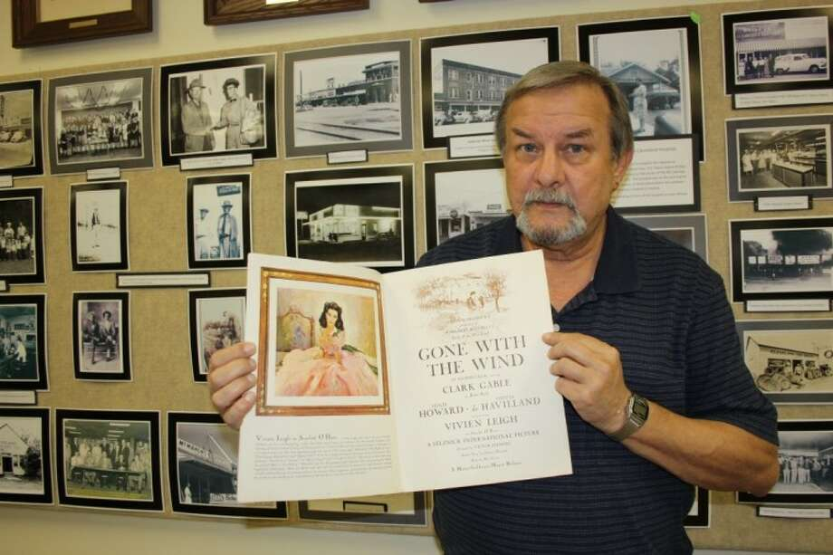 "In addition to photos, the Cleveland Historical Society Museum has many items from the past. James Hefley shows off an original movie program of ""Gone with the Wind"" that was purchased in Houston at the movie's premier. Photo: MELECIO FRANCO"