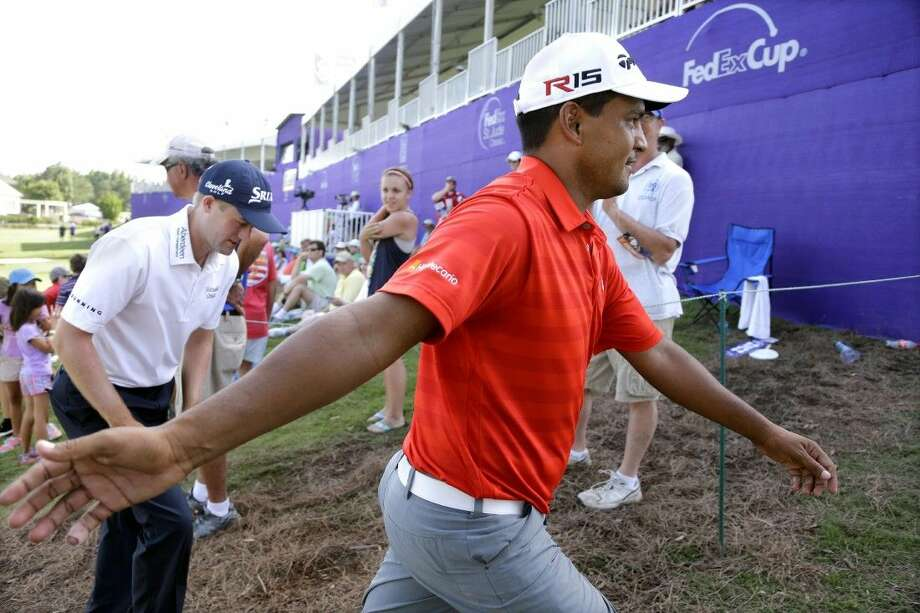 Fabian Gomez greets fans as he leaves the 18th green during the third round of the St. Jude Classic golf tournament Saturday in Memphis, Tenn. Photo: Mark Humphrey
