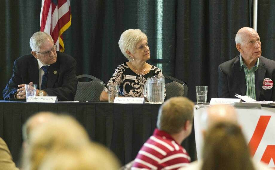Conroe Mayor candidates Toby Powell, Doris Hickman and Jim Gentry are seen during a political forum at Lone Star Convention & Expo Center Thursday in Conroe. Photo: Jason Fochtman