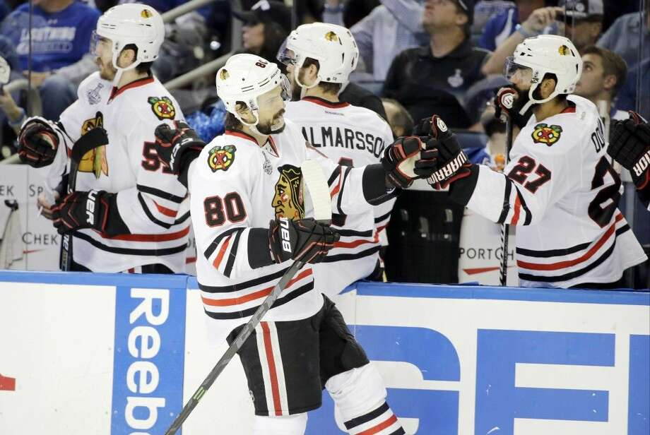 Chicago Blackhawks center Antoine Vermette is congratulated by teammates after scoring against the Tampa Bay Lightning during the third period of Game 5 Saturday, in Tampa, Fla. Photo: Chris O'Meara