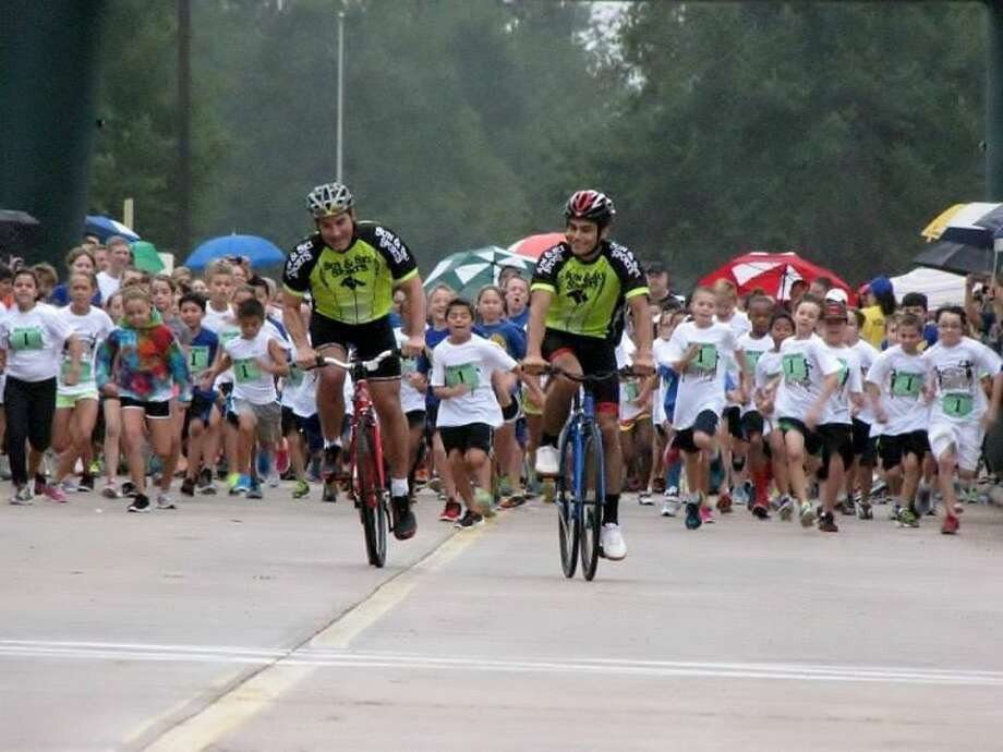 Young runners participate in the 1K Kids Run to raise funds for Klein High School After-Prom Extravaganza.