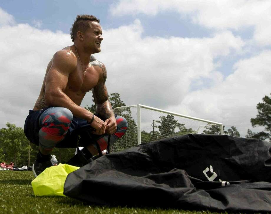 Daniel Lasco, former football player for The Woodlands and NFL hopeful, takes a break between workout sets at Bear Branch Sports Complex in The Woodlands Tuesday. The former high school All-American and California running back looks to break into the NFL after taking part in the NFL scouting combine. Photo: Jason Fochtman