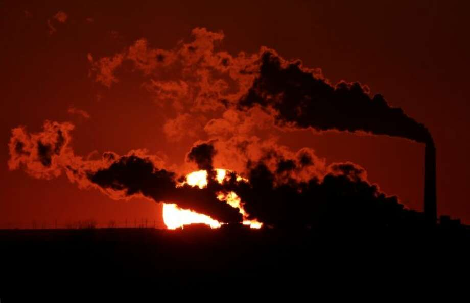 In this March 8, 2014 file photo steam from the Jeffrey Energy Center coal-fired power plant is silhouetted against the setting sun near St. Marys, Kan. As President Barack Obama prepares to announce tougher new air quality standards affecting coal-fired power plants, lawmakers in about a half-dozen state already have acted pre-emptively. Not to toughen their own standards, but to make it tougher to enforce the new federal ones. Photo: Charlie Riedel