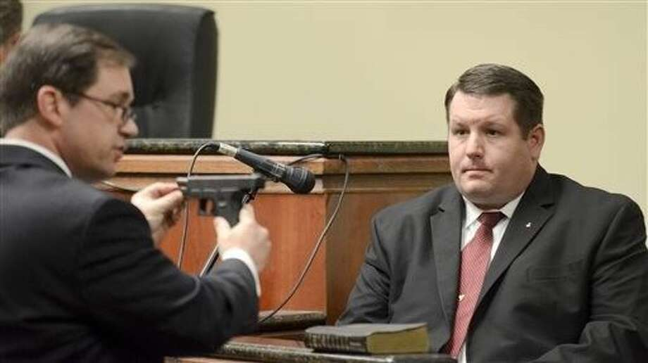 FILE - In this Jan. 8, 2015 file photo, First Circuit Solicitor David Pascoe, left, shows defendant former Eutawville Police Chief Richard Combs the weapon he used to shoot Bernard Bailey during testimony in Combs' first murder trial in Orangeburg, SC. The jury deadlocked in the case and Combs goes on trial a second time in Columbia on Monday. Photo: Larry Hardy