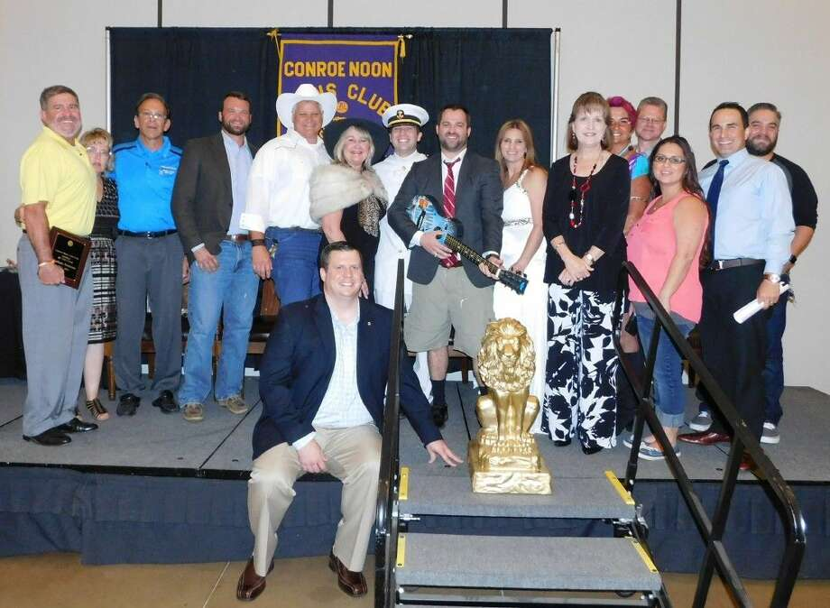 The cast & crew from the Conroe Noon Lions Club take a final ovation after their Academy Awards presentation during the club's Pride Awards & Installation Luncheon last week.