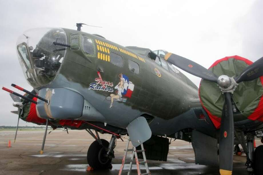 "The B-17G ""Texas Raiders"" from the Commemorative Air Force sits quiet on Saturday after rain delayed any flights until Sunday. Photo: Kar B Hlava"