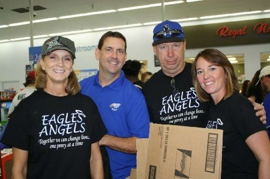 Members of New Caney ISD's coaching staff Sara Sheppard, Brian Tarvin, Donnie Randell and Deana Eubanks all participated in last year's Eagles Angels shopping trip, where they purchased food and clothing for impoverished families in the New Caney area. Photo: Submitted Photo
