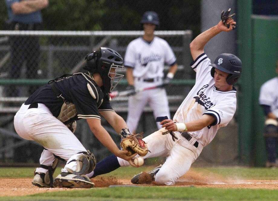 College Park's Harper Lucas beats the tag by Conroe catcher Scott Horn to score off a suicide squeeze bunt by Travis Washburn during the sixth inning of a District 16-6A baseball game Friday. Go to HCNpics.com to purchase this photo and others like it. Photo: Jason Fochtman