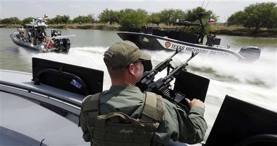 FILE - In this July 24, 2014 file photo, Texas Department of Safety Troopers patrol on the Rio Grande along the U.S.-Mexico border, in Mission. The state's new Republican governor, Greg Abbott, this month approved 800 million for border security over the next two years, more than double any similar period under 14 years of Perry, and by comparison, more than the state spends on environmental regulation. Photo: Eric Gay