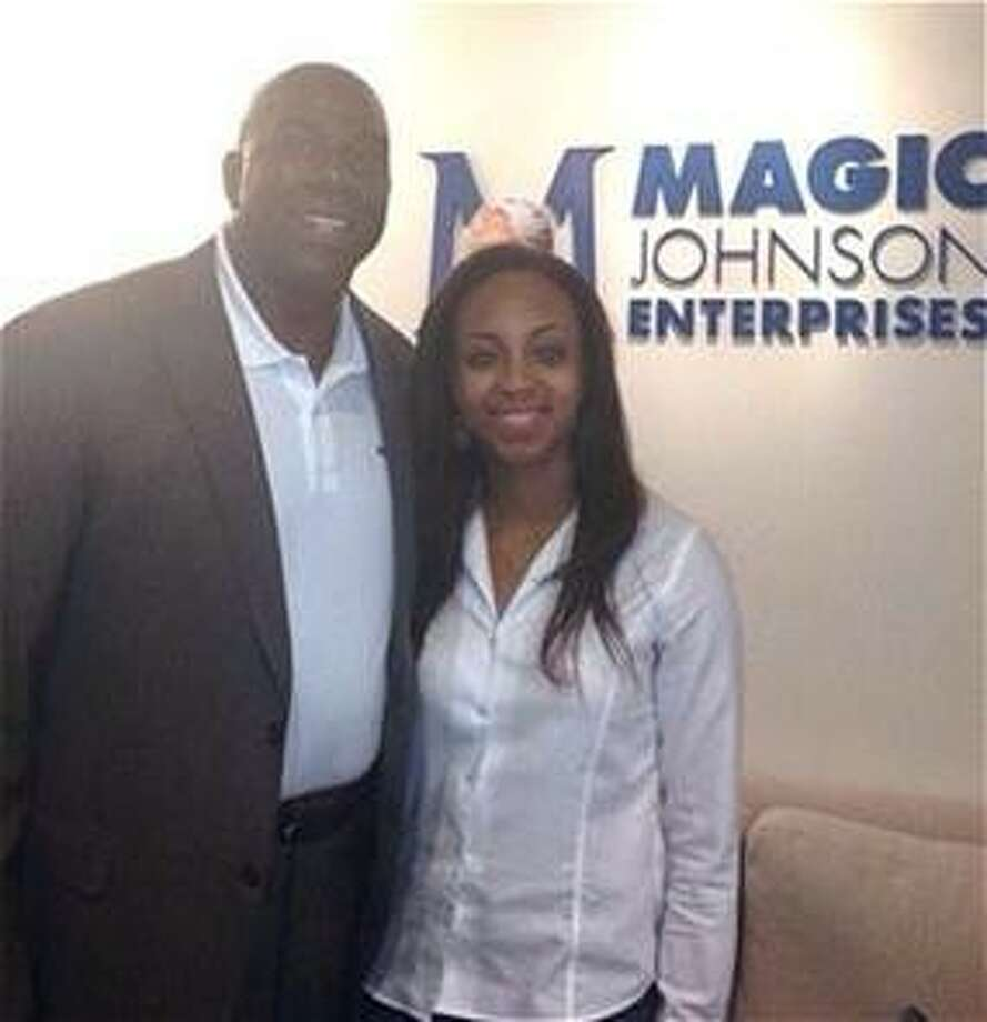 "Tabitha Elder, Klein Forest High School 2013 magna cum laude graduate, is shown with NBA Hall of Fame player Earvin ""Magic"" Johnson."