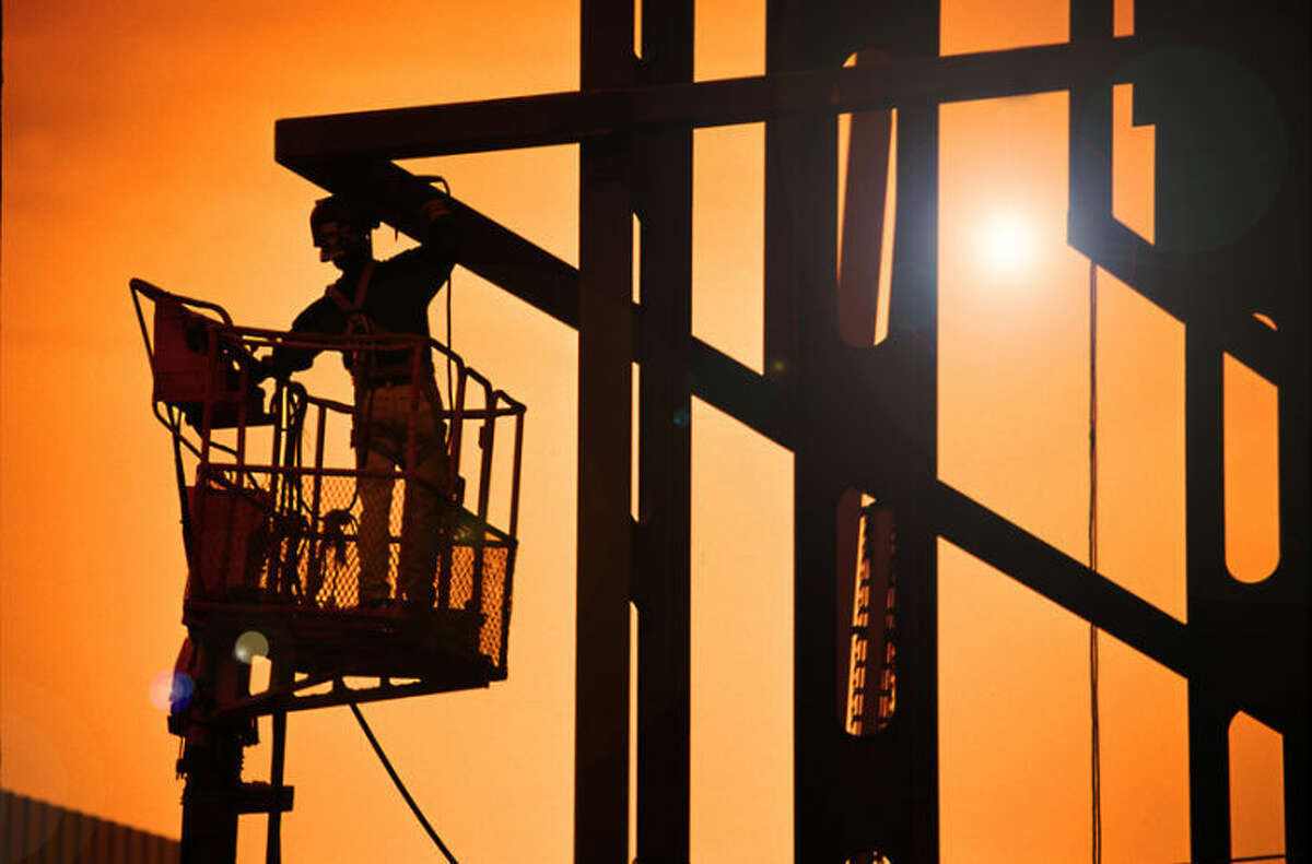 A welder works on a steel structure at sundown. A new report finds Texas and other southern states must create more opportunities, especially for people of color, to train for middle-skill jobs - those that require more training after high school, but not a college degree.