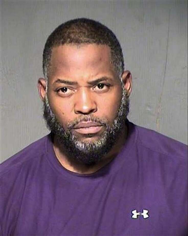 This undated law enforcement booking photo from the Maricopa County, Ariz., Sheriff's Department shows Abdul Malik Abdul Kareem. Kareem, 43, also known as Decarus Thomas, has been charged with helping plan an attack on a provocative Prophet Muhammad cartoon contest in Texas that ended with two men being killed in a shootout with police. An indictment filed in federal court in Phoenix alleges that Kareem hosted the gunmen in his home beginning in January and provided the guns they used in the May 3 shooting in Garland, Texas.(Maricopa County Sheriff's Department via AP) Photo: HOGP
