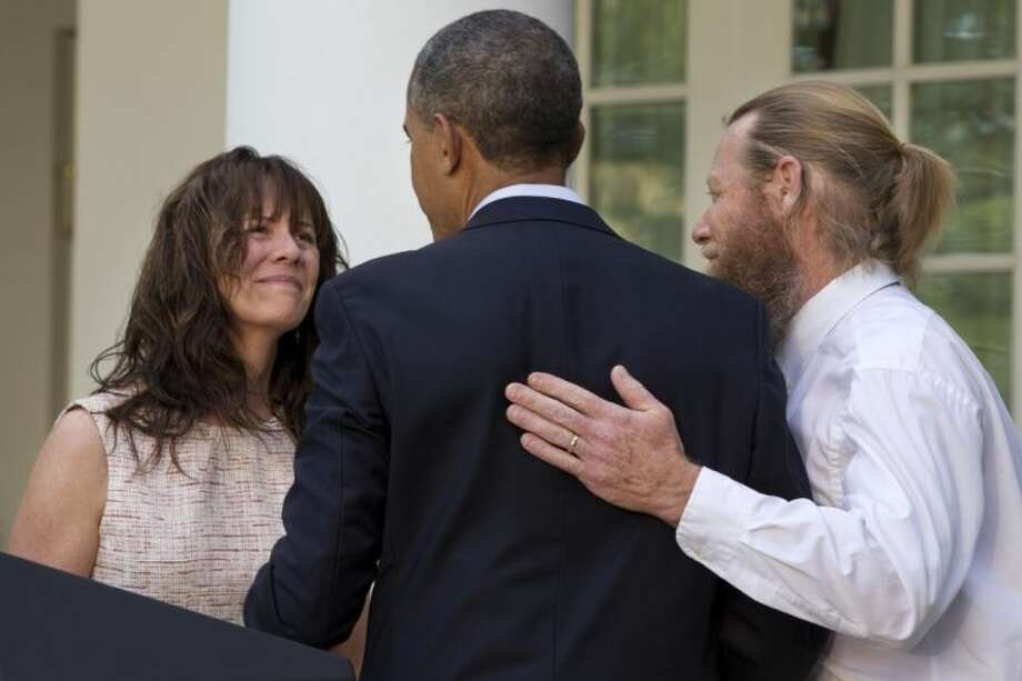 Parents of U.S. Army Sgt. Bowe Bergdahl, Jani Bergdahl, left, and Bob Bergdahl, turn to President Barack Obama after he spoke in the Rose Garden of the White House in Washington Saturday after the announcement that Bowe Bergdahl had been released from captivity in Afghanistan.