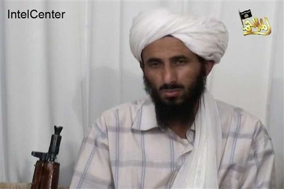 FILE - This image from video released Jan. 23, 2009, by al-Malahim Media Foundation and provided by IntelCenter on Dec. 30, 2009, shows the leader of Al-Qaida in the Arabian Peninsula, identified by the IntelCenter as Nasir al-Wahishi, in Yemen. Al-Qaida on Tuesday, June 16, 2015 confirmed that al-Wahishi, its No. 2 figure and leader of its powerful Yemeni affiliate, was killed in a U.S. strike, making it the harshest blow to the global militant network since the killing of Osama bin Laden. Photo: HONS