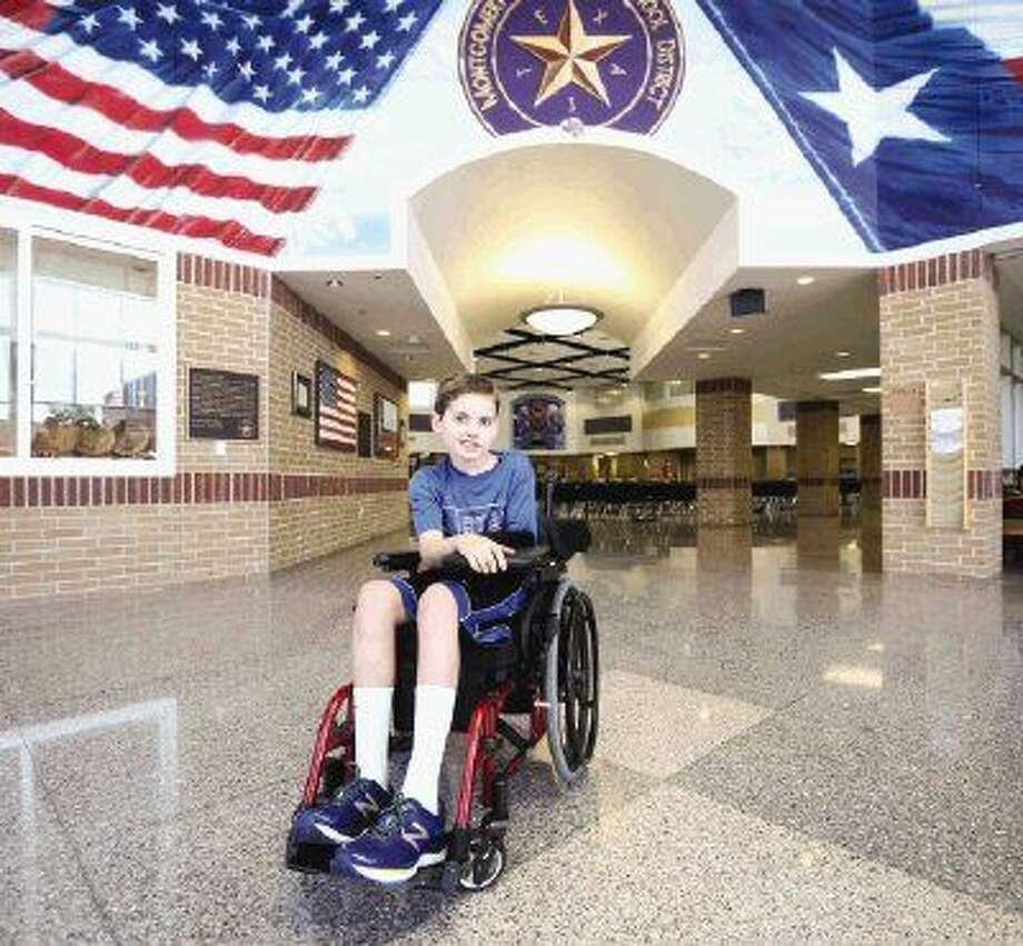 Ryan Logan poses for a portrait on Friday at Montgomery Junior High School. Photo: Michael Minasi