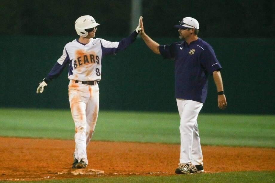 Montgomery's Brandon Shearer (8) celebrates after getting a hit during a high school baseball game against Klein Oak on Tuesday at Montgomery High School. To view more photos from the game, go to HCNPics.com.