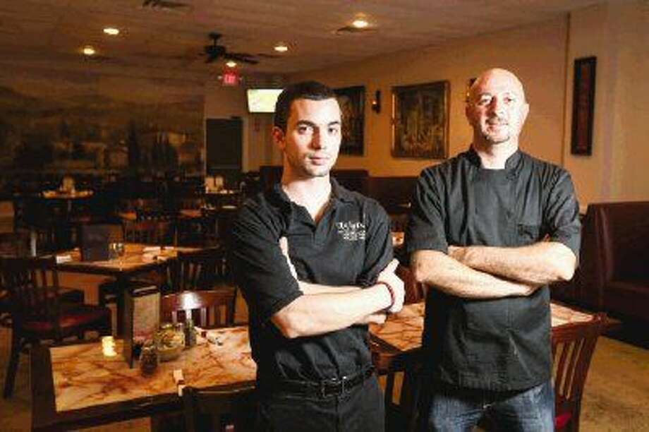 Owner Marko Rezart poses for a portrait with head server Mark Lozelle on Tuesday at Luigi's Italian Restaurant in Conroe. Luigi's serves southern Italian food cooked to order, according to Rezart. Photo: Michael Minasi