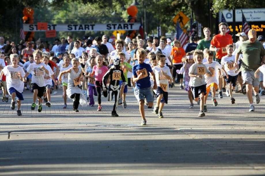 Kids take off running at the annual Halloween Fun Run in 2012.