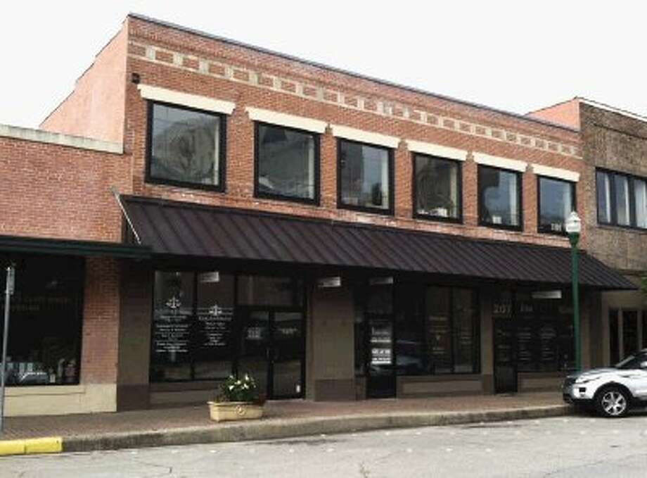 The Etheridge Building as it stands today in downtown Conroe on the south side of the courthouse. The Etheridge Building was purchased from, Obie's son, Whitson Etheridge, by Rocky DePapa about 2007 who remodeled the building into law offices a few years ago. Several attorneys practice in the building today. The Etheridge Building in downtown Conroe in 2006 when it was home to a barber shop and Coronelli's Italian restaurant. Courtesy photo
