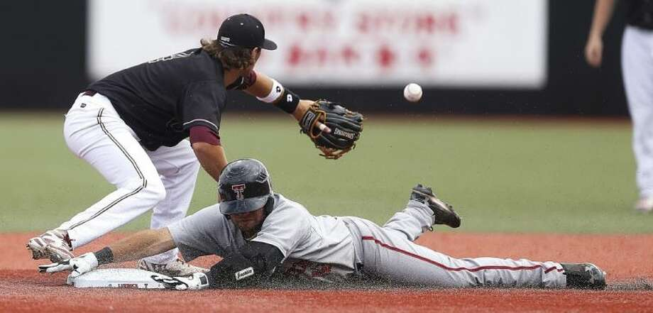 Texas Tech's Eric Gutierrez, right, slides into second base as College of Charleston's Champ Rowland takes a late throw. The Red Raiders won 1-0, earning its first CWS berth. Photo: Shannon Wilson