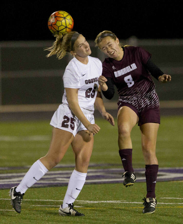 Brooke Mallory, of Magnolia, challenges a header during a Region III-5A area round playoff game at College Station High School Friday in College Station. Go to HCNpics.com to purchase this photo and others like it. Photo: Jason Fochtman