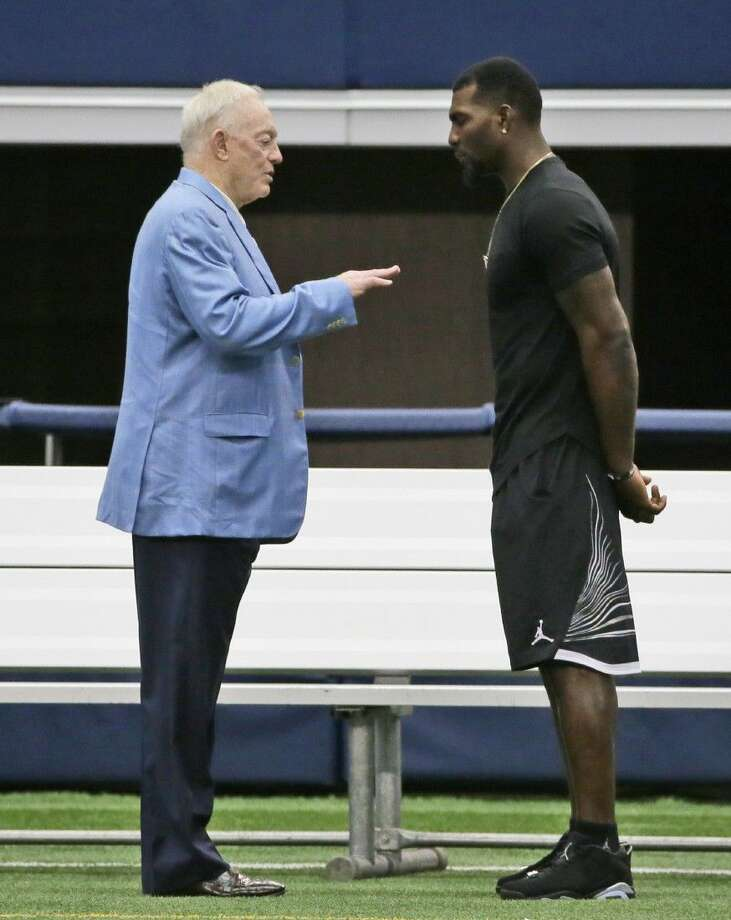 Dallas Cowboys wide receiver Dez Bryant, right, listens to team owner Jerry Jones on the sidelines during minicamp in Arlington, Texas, Thursday. Photo: LM Otero