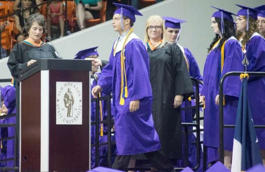 Willis High School Class of 2014 graduates received their diplomas Friday night at Johnson Coliseum in Huntsville. Pictured is Salutatorian Devon Douglis takes the stage as he is introduced to the audience.