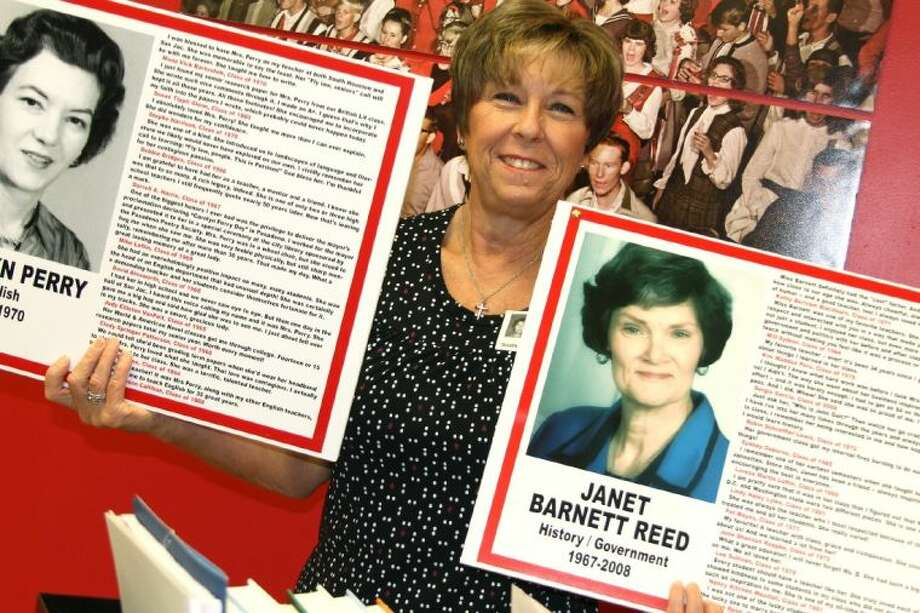 Terry Tand Beeson, a 1970 South Houston High graduate and volunteer at the school, displays tribute posters for Hall of Honor teachers Carolyn Perry and Janet Barnett Reed. Photo: AL CARTER