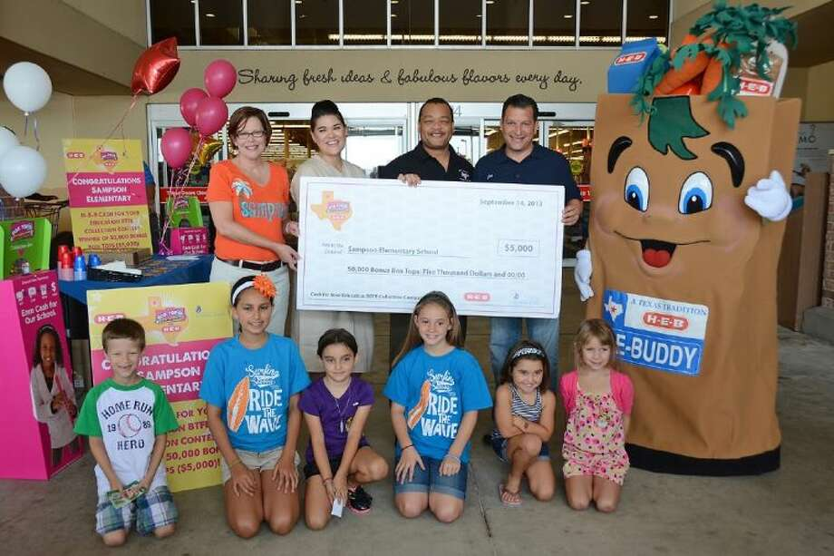 Sampson Elementary School celebrates its $5,000 prize from H-E-B and General Mills after winning the Cash for Your Education / Box Tops for Education Collection Contest. Pictured at the Sept. 14 celebration are (top row, L-R): Sampson principal Heather Motzny, General Mills representative Mai Crone, H-E-B Cypress Market grocery manager Norman Hicks, H-E-B Cypress Market store manager Joe Scala and H-E-Buddy; and (front row, L-R) Sampson students Grayson Williams, Abigail Ramcharan, Andrea Smith, Kayden Bird, Mia Smith and Mylee Ferreira.
